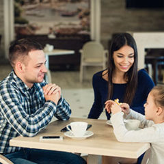 Couple with a kid at a cafe